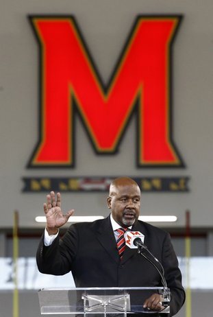 The Associated Press BACK HOME: Maryland's new head football coach Mike Locksley speaks Thursday at a new conference in College Park, Md.