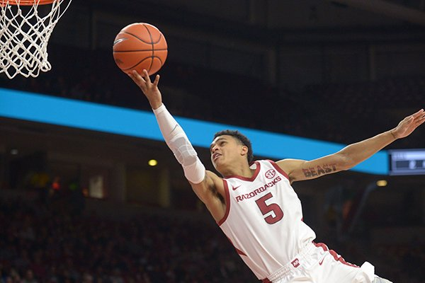 Arkansas guard Jalen Harris goes for a layup during a game against Texas-Arlington on Friday, Nov. 23, 2018, in Fayetteville.
