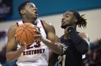 Western Kentucky center Charles Bassey (23) drives while guarded by Central Florida forward Chad Brown (21) during an NCAA college basketball game in the Myrtle Beach Invitational on Sunday, Nov. 18, 2018, in Conway, S.C. (Austin Anthony/Daily News via AP)