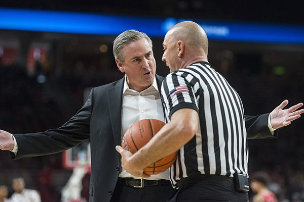 Western Kentucky coach Rick Stansbury talks to an official during a game against Arkansas on Saturday, Dec. 8, 2018, in Fayetteville.