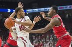 Arkansas' Daniel Gafford (10) is guarded by Western Kentucky's Charles Bassey during a game Saturday, Dec. 8, 2018, in Fayetteville.