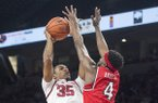 Reggie Chaney (35) of Arkansas attempts a shot as Josh Anderson of Western Kentucky guards Saturday, Dec. 8, 2018, at Bud Walton Arena in Fayetteville.