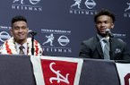 Heisman Trophy finalists, from left, Dwayne Haskins, from Ohio State; Tua Tagovailoa, from Alabama; and Kyler Murray, from Oklahoma, share a light moment during a media event Saturday, Dec. 8, 2018, in New York. (AP Photo/Craig Ruttle)