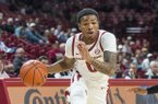 Desi Sills of Arkansas dribbles past Donovan Donaldson of Tusculum in the first half Friday, Oct. 26, 2018, during an exhibition game in Bud Walton Arena in Fayetteville.