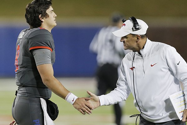 SMU head coach Chad Morris, right, gives encouragement to quarterback Ben Hicks (8) during the second half of an NCAA college football game against South Florida Saturday, Nov. 19, 2016, in Dallas. South Florida won 35-27. (AP Photo/Brandon Wade)