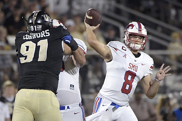 SMU quarterback Ben Hicks (8) throws a pass in front of Central Florida defensive lineman Joey Connors (91) during the first half of an NCAA college football game Saturday, Oct. 6, 2018, in Orlando, Fla. (AP Photo/Phelan M. Ebenhack)