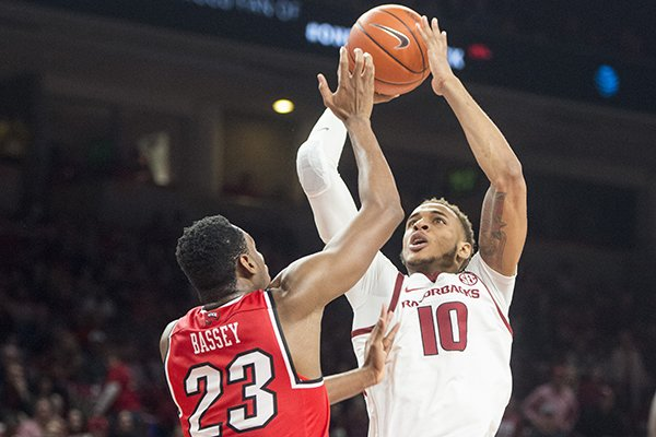 Daniel Gafford of Arkansas shoots as Charles Bassey of Western Kentucky defends in the second half of a game Saturday, Dec. 8, 2018, at Bud Walton Arena in Fayetteville.