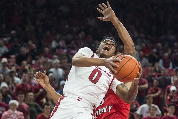 Desi Sills (0) of Arkansas gets fouled by Desean Murray of Western Kentucky in the second half of a game Saturday, Dec. 8, 2018, at Bud Walton Arena in Fayetteville.