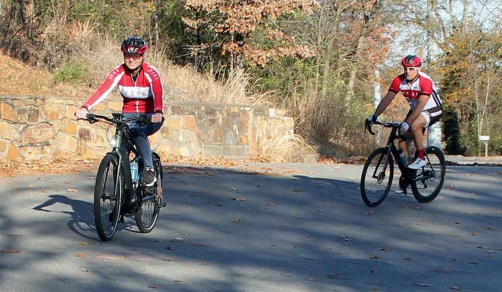 Regina Seelinger and her husband, Mat, ride uphill toward Fort Roots in North Little Rock. Regina is on her electric bike, which makes riding up hills much easier.