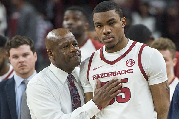 Arkansas coach Mike Anderson (left) consoles freshman forward Reggie Chaney after Arkansas fell 78-77 to Western Kentucky on Saturday, Dec. 8, 2018, at Bud Walton Arena in Fayetteville.