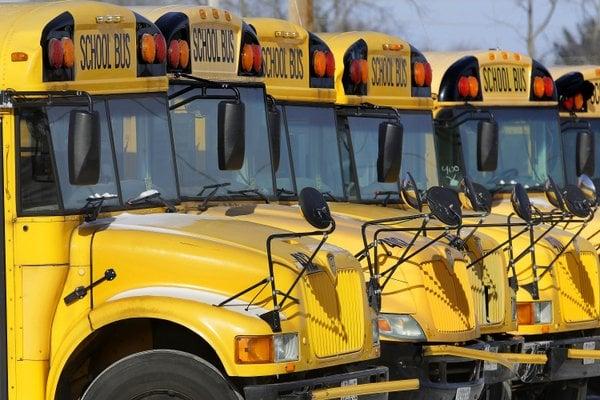 Dump truck hits Arkansas school bus; 9 people go to hospital