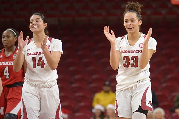 Arkansas guards Chelsea Dungee (33) and Jailyn Mason (14) celebrate during the closing moments against Nebraska Tuesday, Dec. 18, 2018, during the second half of the Razorbacks' 84-80 win in Bud Walton Arena.