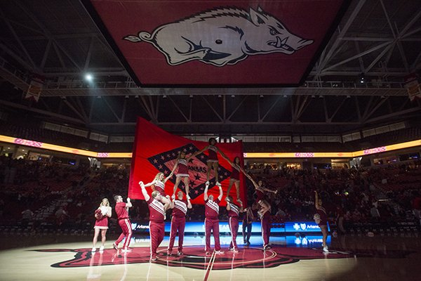Arkansas cheerleaders perform during a timeout of a game between the Razorbacks and Western Kentucky on Saturday, Dec. 8, 2018, in Fayetteville.