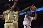 Arkansas forward Reggie Chaney takes a shot while he is defended by Georgia Tech's Moses Wright (5) and James Banks III (1) during a game Wednesday, Dec. 19, 2018, in Fayetteville.