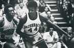 Arkansas guard Marvin Delph (44) dribbles against a Kansas State defender during a game Dec. 20, 1976, in Fayetteville.