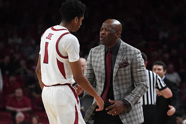 Arkansas coach Mike Anderson talks to freshman guard Isaiah Joe during Arkansas' 69-65 loss to Georgia Tech on Wednesday Dec. 19, 2018, at Bud Walton Arena in Fayetteville.