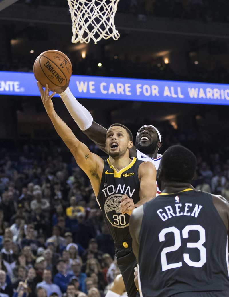 1bf4b059b The Associated Press WARRIOR FINISH  Golden State Warriors guard Stephen  Curry (30) scores the final basket against the Los Angeles Clippers in the  fourth ...