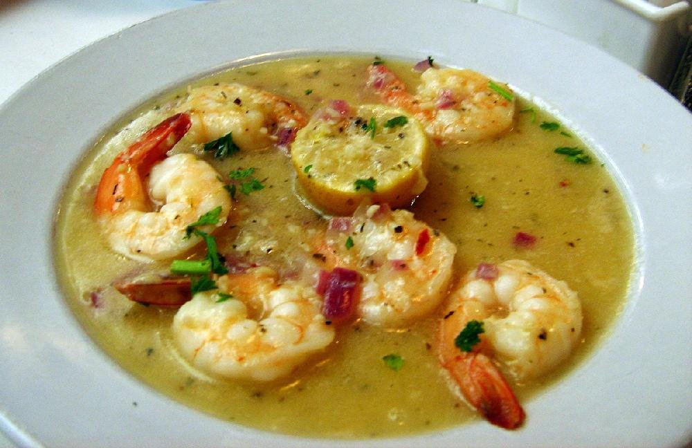 A side order of Shrimp Napolini at Roma Italian Restaurant in Jacksonville is made with jumbo shrimp sauteed with shallots in a white wine, lemon butter and garlic sauce.