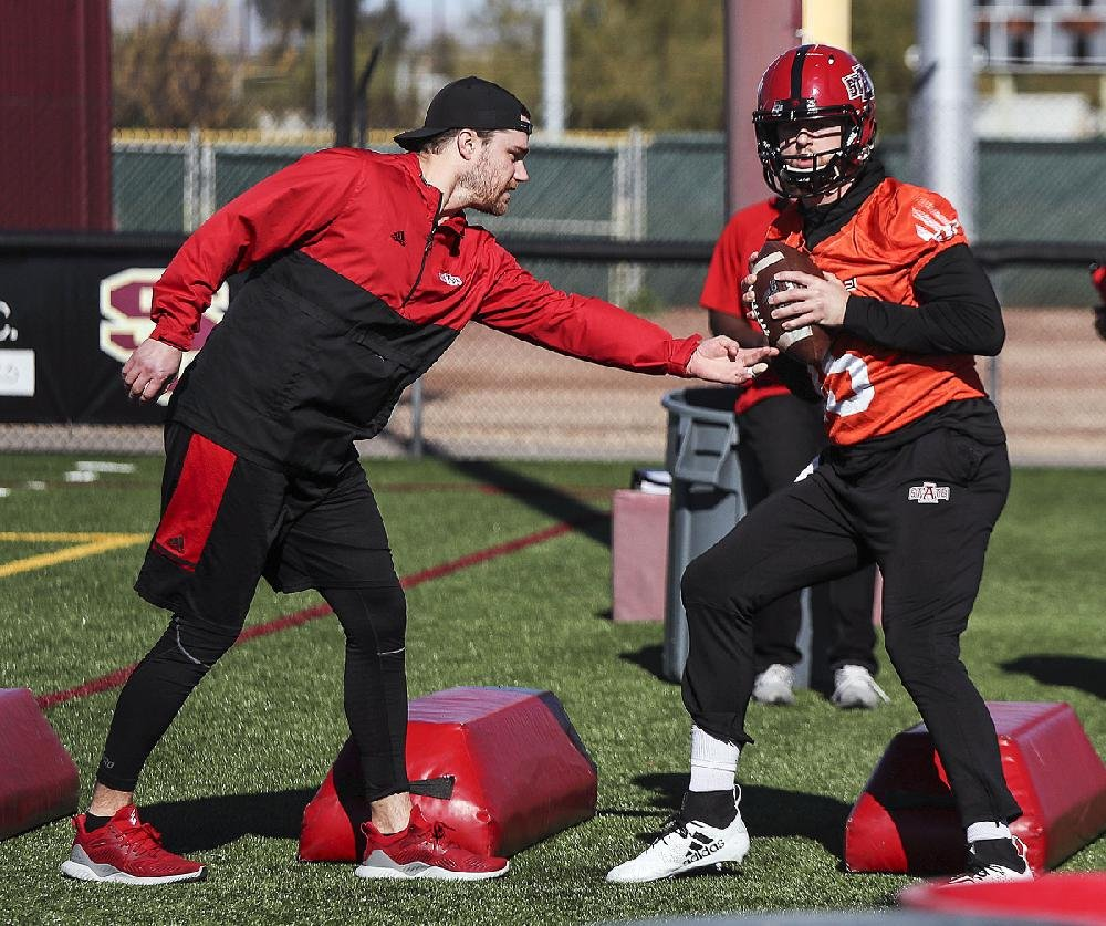 Arkansas State quarterback Justice Hansen (right) runs through a drill Thursday as the Red Wolves continue preparations for their matchup against the Nevada Wolf Pack in the Arizona Bowl in Tucson, Ariz. For more photos, visit arkansasonline.com/galleries.