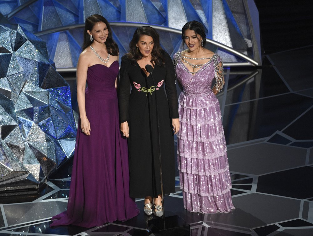 In this March 4 file photo, Harvey Weinstein accusers, Ashley Judd, from left, Annabella Sciorra and Salma Hayek speak at the Oscars in Los Angeles. (Photo by Chris Pizzello/Invision/AP, File)