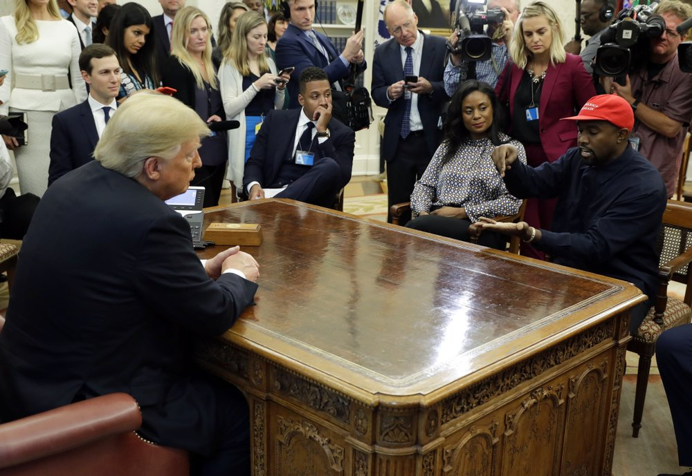 In this Oct. 11 file photo, rapper Kanye West speaks to President Donald Trump and others in the Oval Office of the White House in Washington. (AP Photo/Evan Vucci, File)
