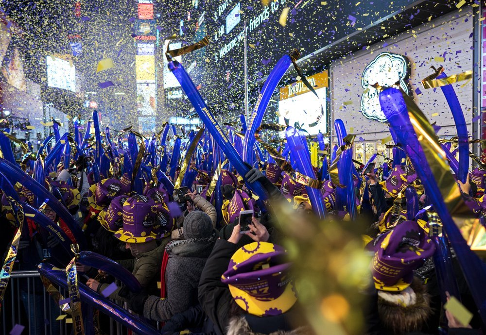 In this Dec. 31, 2016 file photo, confetti falls during one of the hourly countdowns as revelers take part in a New Year's Eve celebration in New York's Times Square. Year after year, people watching New York City's New Year's Eve celebration are told by city dignitaries and TV personalities that they are watching a million people gathered in Times Square. The AP asks experts whether it is actually possible to fit that many people into the viewing areas. (AP Photo/Craig Ruttle, File)