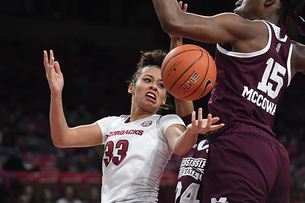 Arkansas' Chelsea Dungee has a shot blocked by Mississippi State's Teaira McCowan during a game Thursday, Jan. 3, 2019, in Fayetteville.