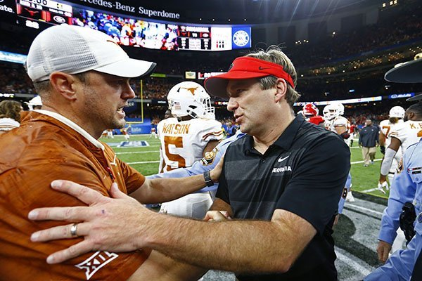 Texas coach Tom Herman, left, greets Georgia coach Kirby Smart after the Sugar Bowl NCAA college football game in New Orleans, Tuesday, Jan. 1, 2019. Texas won 28-21. (AP Photo/Butch Dill)