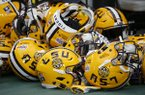 LSU football helmets are shown in the first half during the Fiesta Bowl NCAA college football game against UCF, Tuesday, Jan. 1, 2019, in Glendale, Ariz. (AP Photo/Rick Scuteri)