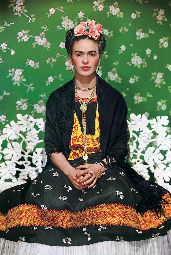 "Frida Khalo on White Bench, New York, a color carbon print, was taken in 1939 by Nickolas Muray cq. It will hang in ""Photographing Frida: Portraits of Frida Kahlo/Fotografiando Frida: Retratos de Frida Kahlo,"" which opens Feb. 1 at the Arkansas Arts Center. (Throckmorton Fine Art, New York)"