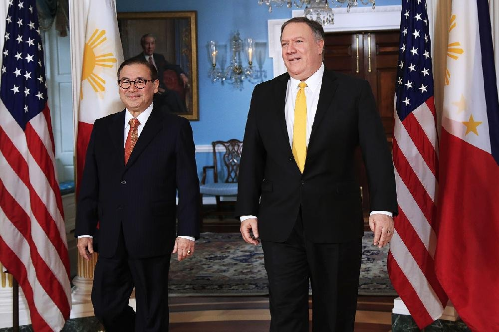 Secretary of State Mike Pompeo, right, and Philippines Foreign Secretary Teodoro Locsin walk to towards the Treaty Room at the State Department in Washington.
