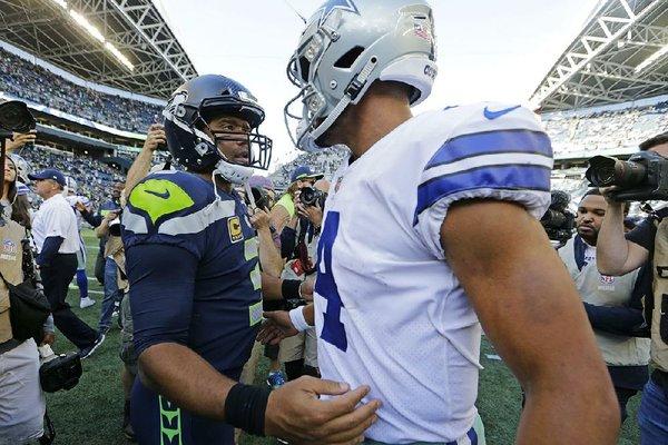 853cd7b2cec Seattle Seahawks quarterback Russell Wilson (left) speaks with Dak Prescott  of the Dallas Cowboys