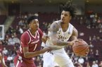 Texas A&M's Brandon Mahan, right, tries to pass the ball around Arkansas' Isaiah Joe (1) in the first half of an NCAA college basketball game Saturday, Jan. 5, 2019, in College Station, Texas. (Laura McKenzie/College Station Eagle via AP)