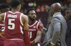 Arkansas guard Keyshawn Embery-Simpson (11) speaks with head coach Mike Anderson as officials review a play in the first half of an NCAA college basketball game against Texas A&M, Saturday, Jan. 5, 2019, in College Station, Texas. (Laura McKenzie/College Station Eagle via AP)