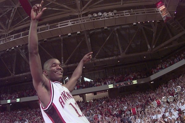 Kareem Reid celebrates following Arkansas' 1999 upset of Kentucky at Bud Walton Arena.