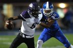 Bryant defensive end Catrell Wallace (88) tackles Fayetteville quarterback Darius Bowers (5) during the second quarter of Bryant's 28-25 win on Friday, Nov. 16, 2018, at Bryant High School.