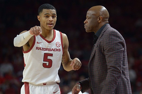 Arkansas guard Jalen Harris speaks with coach Mike Anderson against Texas State Saturday, Dec. 22, 2018, during the second half in Bud Walton Arena.
