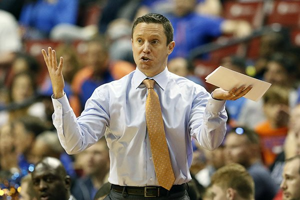 In this Dec. 22, 2018, file photo, Florida head coach Mike White reacts in the first half of play against Florida Gulf Coast in an NCAA college basketball game, part of the Orange Bowl Classic tournament, in Sunrise, Fla. Florida coach Mike White has three guys he can count on to bring energy and effort every day. Problem is two of them are freshmen. Although that might bode well for the future of the program, it's not how the Gators were expected to play in White's fourth season. So the coach is scratching his head and searching for answers as Florida (8-5, 0-1 Southeastern Conference) prepares to play at Arkansas (10-3, 1-0) on Wednesday night, Jan. 9, 2019. (AP Photo/Joe Skipper, File)