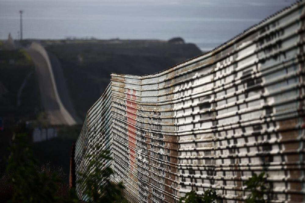 A section of border wall seen Tuesday runs toward the Pacific Ocean near Tijuana, Mexico.