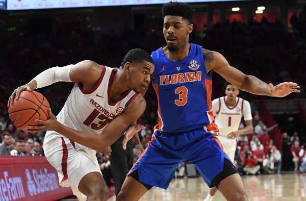 Arkansas' Mason Jones looks for help while Florida's Jalen Hudson defends Wednesday Jan. 9, 2019 at Bud Walton Arena in Fayetteville.