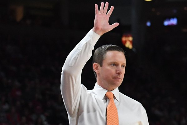 Florida coach Mike White motions to his players during a game against Arkansas on Wednesday, Jan. 9, 2019, in Fayetteville.