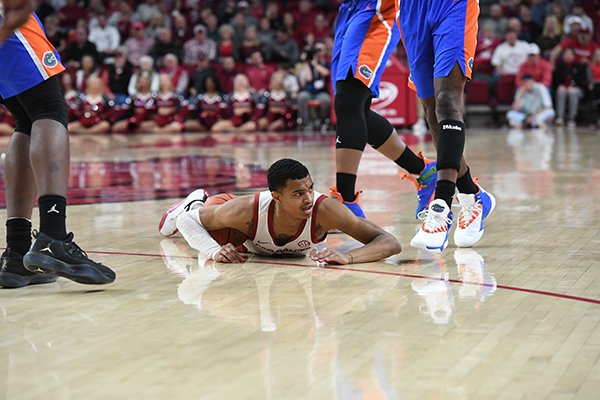 Arkansas guard Jalen Harris lays on the floor during a game against Florida on Wednesday, Jan. 9, 2019, in Fayetteville.
