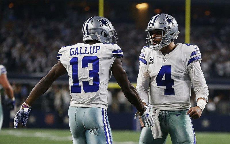 Dallas Cowboys quarterback Dak Prescott (4) congratulates Michael Gallup  after they connected on a touchdown pass last week against Seattle. 312e0cdde