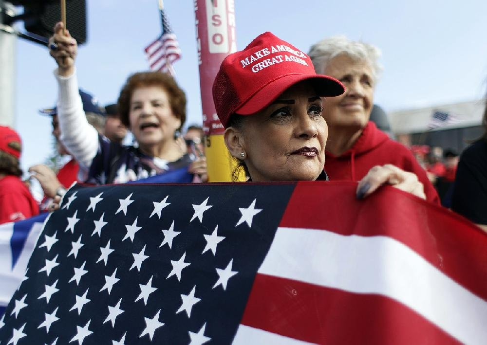 Supporters of President Donald Trump wait for his arrival Thursday at McAllen International Airport in southern Texas.