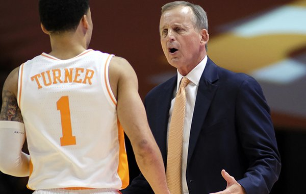 Tennessee head coach Rick Barnes speaks with Tennessee guard Lamonte Turner (1) during a time out in the second half of an NCAA college basketball game against Georgia Saturday, Jan. 5, 2019, in Knoxville, Tenn. Tennessee won 96-50. (AP Photo/Shawn Millsaps)