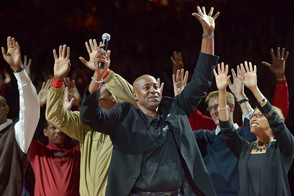 Former Arkansas basketball player Sidney Moncrief leads a Hog Call during halftime of a game between the Razorbacks and Mississippi State on Saturday, Feb. 7, 2015, in Fayetteville.