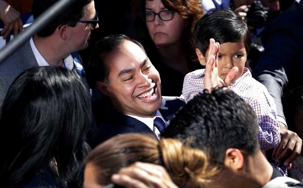 Former San Antonio Mayor and Housing and Urban Development Secretary Julian Castro, center, greets supporters during an event where he announced his decision to seek the 2020 Democratic presidential nomination, Saturday, Jan. 12, 2019, in San Antonio.