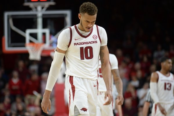 Arkansas forward Daniel Gafford walks to the bench in the closing moments of regulation against LSU Friday, Jan. 11, 2019, during the second half of play in Bud Walton Arena in Fayetteville. Visit nwadg.com/photos to see more photographs from the game.