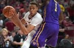 Arkansas' Daniel Gafford drives to the basket while Louisiana State's Duop Reath defends Wednesday Jan. 10, 2018 at Bud Walton Arena in Fayetteville. LSU won 75-54.