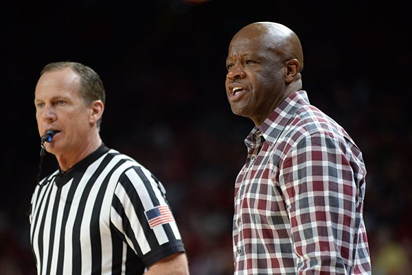 Arkansas coach Mike Anderson speaks to a game official against LSU Friday, Jan. 11, 2019, during the second half of play in Bud Walton Arena in Fayetteville. Visit nwadg.com/photos to see more photographs from the game.